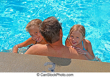 kids with dad in pool