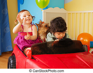 Kids with dog in the car