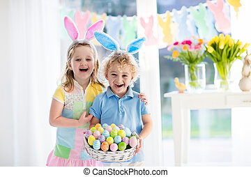Kids with eggs basket on Easter egg hunt - Little boy and ...