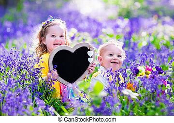 Kids with flowers and chalk board