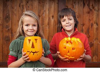 Kids with Halloween pumpkin jack-o-lanterns