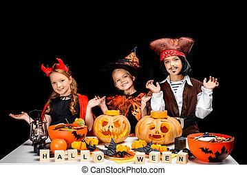 kids with halloween pumpkins