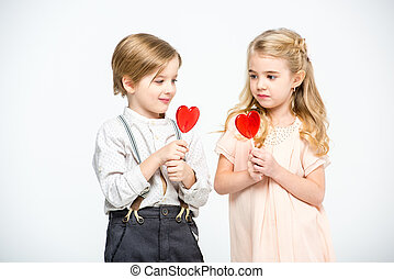 Kids with heart shaped lollipops