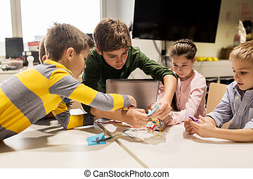 kids with invention kit at robotics school - education,...