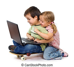 Kids with laptop playing