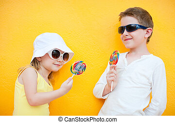 Kids with lollipops