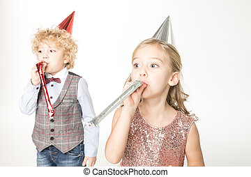 Kids with party blowers