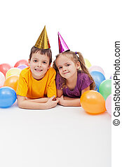 Kids with party hats and balloons