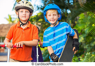 Kids with Skate Boards and Scooters - Group of Neighborhood...