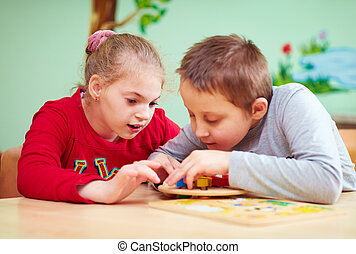 kids with special needs develop their fine motor skills in...