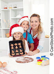 Kids with their mother making christmas cookies