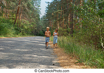 kids wlaking in the woods