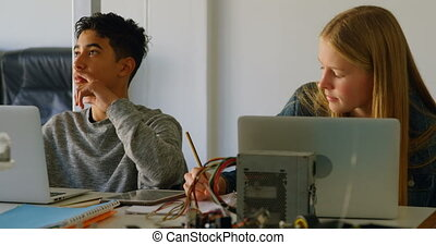 Kids working on a project in the training institute 4k -...