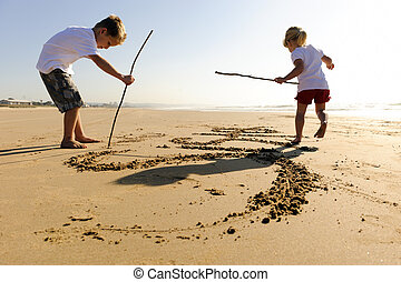 Kids writing in sand