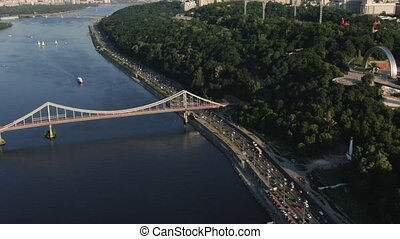 Kiev City Bridge Aerial With City Traffic at Sunset. Traffic...