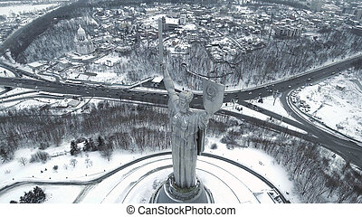 Kiev City - the capital of Ukraine. Mother Motherland, The monument is located on the banks of Dnieper River. Aerial view.