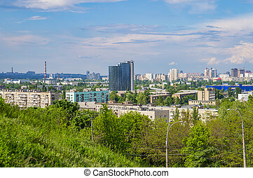Kiev cityscape against the blue sky with white clouds.