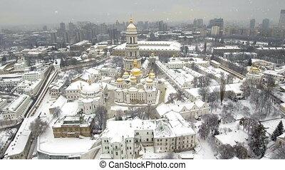 Kiev-Pechersk Lavra. Falling snow in a winter. Kiev,...