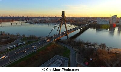 Kiev, Ukraine. Aerial view of Road bridge - Moscow Bridge over Dnieper river. Sunset in Kyiv, Eastern Europe.