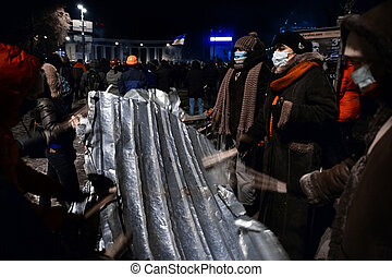 KIEV, UKRAINE - January 20, 2014: Mass anti-government protests in the center of the Ukrainian capital Kiev. People on Hrushevskoho St. preparing to storm by government troops