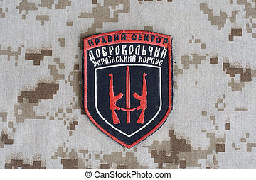 "KIEV, UKRAINE - July, 08, 2015. Chevron of Ukrainian volunteers corps with the words ""Ukrainian Volunteer Corps Right Sector"""