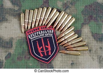 "KIEV, UKRAINE - July, 08, 2015. Chevron of Ukrainian volunteers corps with the words ""Ukrainian Volunteer Corps Right Sector"" with military ammunition"