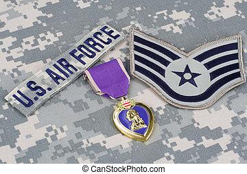 KIEV, UKRAINE - March 6, 2016. Purple Heart award on US AIR FORCE camouflage uniform