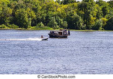 Kiev Ukraine, the Dnieper River 08/15/2016. Pleasure boat floating on the water.