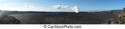 Kilauea Caldera - Sulphurous vapour rises from the young...