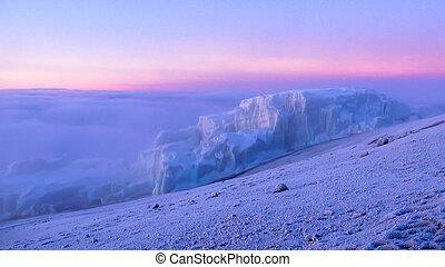 Kilimanjaro glacier at sunrise with snow on the summit