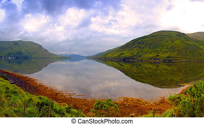 Killary Harbour/An Caoláire Rua is a fjard located in the west of Ireland in the heart of Connemara which forms a natural border between counties Galway and Mayo. It is 16 kilometres long and in the centre over 45 metres deep.