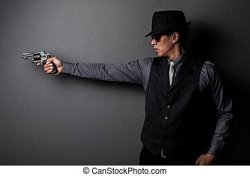 killer and mafia man hold gun