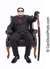 Killer sitting on chair