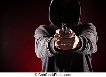 Killer with gun. - Killer with gun close up over dark...