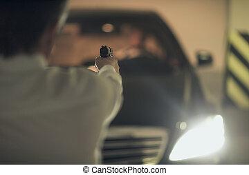 Killer with gun. Rear view of men with handgun aiming the...