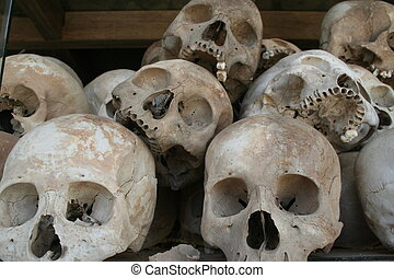 Skulls from the infamous killing fields in Cambodia. More than 8,900 victims were brutally killed and buried in mass graves in Cambodia by the Khmer Rouge. These skulls are on display to show the world the horror and genocide of the Khmer Rouge.