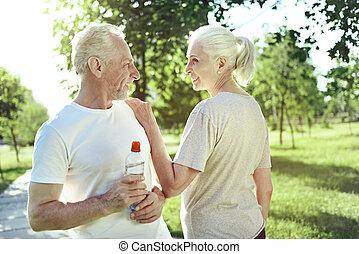 Kind aged woman appreciating her husband