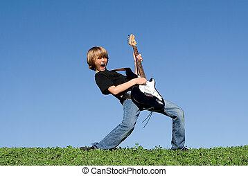 kind gespeel, gitaar, en, het zingen