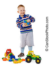 kind gespeel, met, speelgoed, op wit, achtergrond