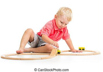 kind gespeel, varen straat uit, speelbal