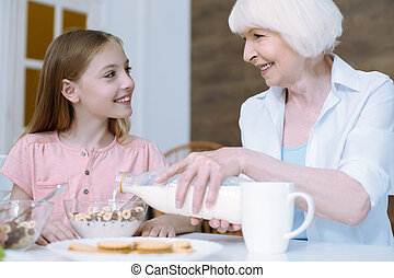 Kind girl looking softly at her granny