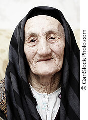 Very old grandmother looking to camera with kind