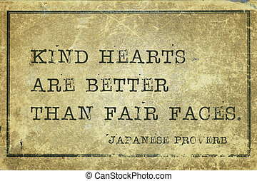 Kind hearts are better than fair faces - ancient Japanese proverb printed on grunge vintage cardboard