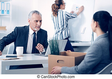 Kind mature chief meeting new employee at office