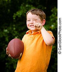 kind, met, voetbal, vieren, door, het tonen, dat, he's, nummer 1