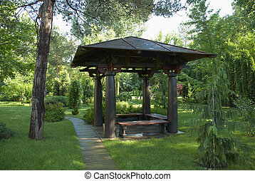 Kind on a beautiful arbour in cosy park