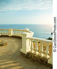 Kind on ocean from a stone balcony