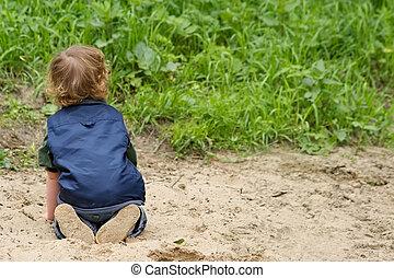 kind, op het strand
