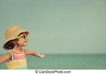kind, relaxen, op het strand