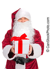 Kind Santa Claus in red costume giving present. While looking at camera and standing isolated over white background